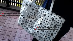 """Rock-3"" handbag by Bao Bao Issey Miyake. Comes with a zipper on top & 2 inner pockets. Shoulder strap adjustable. Very room & can handle A4 File. Good for both working & casual scenes. Color: White Mat Size: H29×W49×D12(cm)  >>To Order, please message/email via the platform below<< ♥️FB Inbox: https://www.facebook.com/messages/baobaohandbags ♥️Email: welovebaobao@gmail.com"