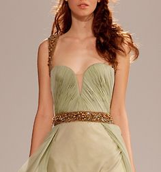 She looks like she could use a meal but the detailing on the bodice is great...