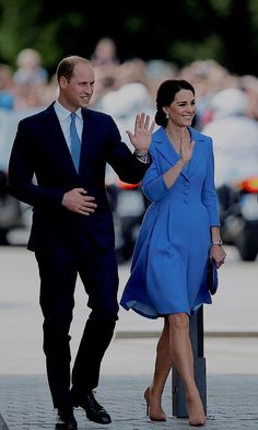 Kate wore a bespoke coat dress by Catherine Walker as the family left Poland and travelled to Germany.