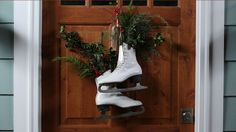 This is our number one holiday door idea of all time (way better than a wreath)! It's so simple: Vintage ice skates, florist's foam, and fir cuttings do the trick. Here are the details.