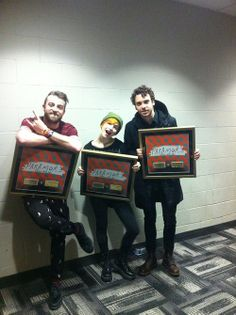 Another photo of Paramore with their gold certifications for Still Into You, which has sold more than 40,000 digital copies in Canada