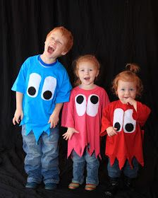 Mr. and Mrs. PacMan and Ghosts Family Costume. Easy ghosts out of too big shirts!