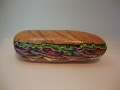 Sliced ham, American cheese, lettuce, tomatoes, cucumbers and onions on a toasted Italian roll. Sounds and looks good enough to eat! Display it on a