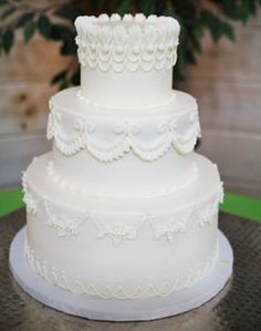White on white, coose a fun colored cake for added pizzazz