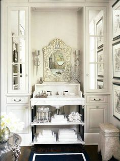 bathroom vanity flanked by mirrored cabinets {wider center section for double sinks; what about a retrofitted dresser, in another color from the built-ins?}