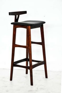 Rosewood and Leather Bar Stools, Denmark, 1960s | From a unique collection of antique and modern stools at https://www.1stdibs.com/furniture/seating/stools/