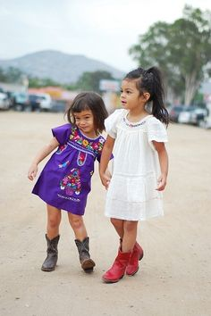 Vintage Mexican tunic dresses kid-style.  I like the look on the one little girls face.  She looks like a handful.