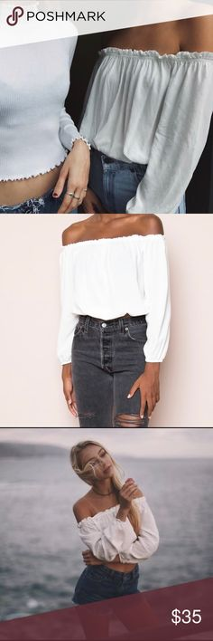 Brandy Melville White Maura Off The Shoulder Top New with tag just wrinkled from storage. Soft woven cotton off-the-shoulder top in white with elasticized shoulders, sleeves and hem with ruffled trimmings and a cropped fit.   100% cotton, One Size.   Measurements: 12 inches long, 15 inches wide while laying flat. Brandy Melville Tops