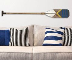 Decorative Oars for the Wall: http://www.completely-coastal.com/2016/03/decorative-oars.html
