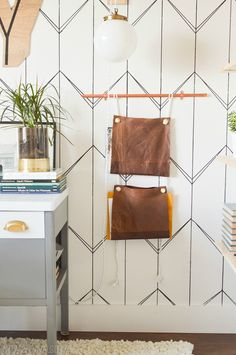 DIY: upcycled leather magazine rack