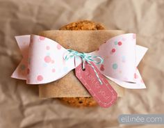 pretty packaging ideas for your special gifts-- three new paper bows for you to download and print in aqua plaid, pink confetti and a buttery yellow pattern. Below is a link to the tutorial of how to assemble these charming paper bows.