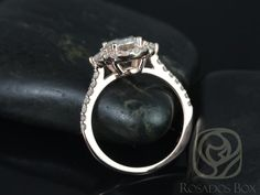 This engagement ring is designed for those who love simple with a slight twist. With the combination of both the 3 stone and halo together, the ring is truly unique! All stones used are only premium cut, fairly traded, and/or conflict-free! Our diamonds are always natural NEVER treated or