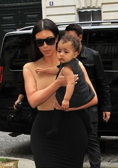 Just days before her parents' wedding, North looked adorable in a little black dress while strolling the streets of Paris with hermom.