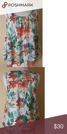 Meadow Rue Floral Swing Top Anthropologie Anthropologie double layer swing top.  Meadow Rue Size L.  NWOT new condition - perfect.  Polyester/Cotton/Modal Anthropologie Tops Blouses