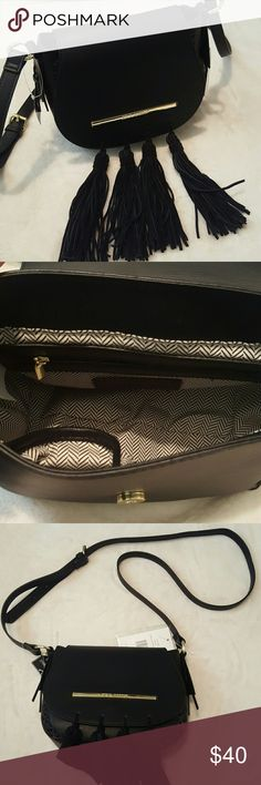 "BRAND NEW Authentic STEVE MADDEN Handbag Authentic STEVE MADDEN Handbag  New with tags attached Exterior: Black faux leather Interior: 100% polyester Light White & Black  Reinforced bottom Front Flap with magnetic closure Interior zippered pocket 2 slip pockets 48"" adjustable, detachable buckle strap (48"" max)  Clutch handle with a 4"" drop Gold-tone hardware Name plate on front flap and clasps Measures: 9""w x 8""h x 4""d Steve Madden Bags Crossbody Bags"