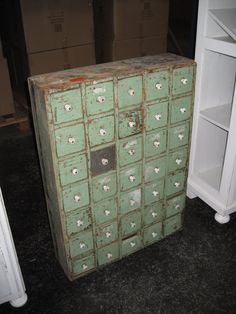 I've been watching for a card catalogue cabinet for a year.  Like the green drawers on this one.