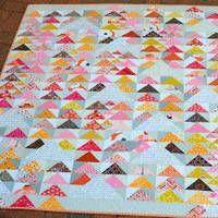 http://hyacinthquiltdesigns.blogspot.com/2013/10/flying-geese-redbird-bee-bloggers-quilt.html