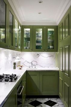The Best in Dark Green Kitchen Trends - Town & Country Living Olive Green Kitchen Cabinets with Checkerboard Floor Two Tone Kitchen Cabinets, Green Cabinets, Kitchen Cabinet Colors, Painting Kitchen Cabinets, Kitchen Paint, New Kitchen, Kitchen Ideas, Eclectic Kitchen, White Cabinets