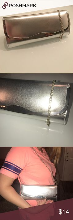 ALDO Silver Clutch w/ Removable Strap Included! Like new (used ONCE)! Great for weddings, parties, going out, or prom! Pictures with iPhone 6 for size reference! Strap is removable or can be tucked in if not needed! Looks cute with or without strap! Minor wear on back (pictured) Bags Clutches & Wristlets