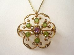 An early 20th century amethyst, pearl and peridot pendant - suffragette colors