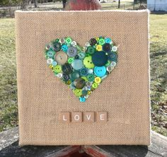 """Rustic Country Green Heart on Burlap Canvas with Scrabble Tile """"LOVE"""" ~ Handmade Button & Bead Wall Art ~ Mother's Day Gift Hessian Crafts, Burlap Art, Burlap Canvas, Scrabble Tile Crafts, Scrabble Wall Art, Button Art, Button Crafts, Button Letters, Canvas Projects Diy"""