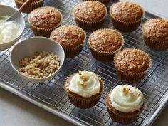 Applesauce is the light secret to making these sweet, spiced carrot cupcakes particularly moist.