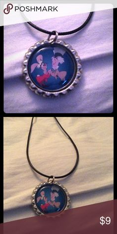 "NWOT Alice in Wonderland hatter and March hare NWOT Alice in Wonderland Hatter and March hare necklace. 18"" faux leather cord bottle cap necklace Jewelry Necklaces"