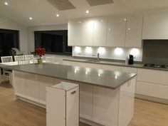 White Kitchen Units With Grey Worktop curved units with gloss white and grey top, lighting a bit too