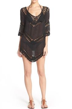 Gauzy tunic with inset crochet panels. Wear as a mini dress cover-up or with a great pair of jeans. 3/4 length sleeves  Crochet Panel Tunic by Beth Friedman. Clothing - Tops - Tunics Arizona