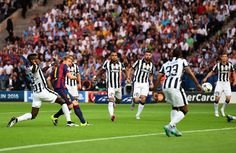 Ivan Rakitic of Barcelona scores the opening goal during the UEFA Champions League Final between Juventus and FC Barcelona at Olympiastadion on June 6, 2015 in Berlin, Germany.