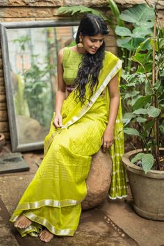 From the locals of Andra Pradesh, this olive green Mangalgiri saree has made its way into our collection. With a refreshing silver border, she is daring to go. The silver strands to three across the saree adds enough zari to the saree to welcome her on those festive days. To complete the look, work her with printed blouse for a little added something. #Limegreen #Mangalagiri #cotton #silk #saree #India #blouse #Houseofblouse