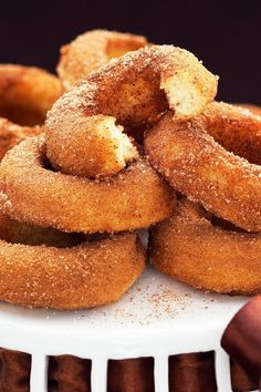 Cinnamon Sugar Baked Doughnuts Recipe - delicious cake doughnuts dipped in butter, then rolled in cinnamon sugar.