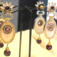 A beautiful pair of earrings in Mother of Pearl & Red stone and Drop