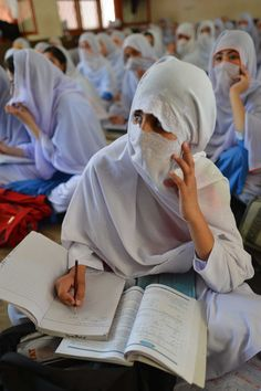 Girls attend class at a school in Mingora, the main town of Swat valley in Pakistan. Mingora, Pakistan, 2013 Photo: A. Majeed/AFP/Getty Images