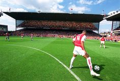 Thierry Henry warms up in front of the North Bank at Highbury
