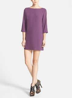 This boatneck chiffon shift dress is a wardrobe staple. Mix and match different tights and shoes to create multiple styles for fall.