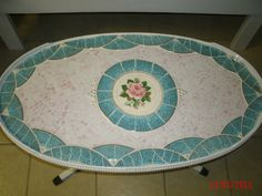 Vintage Coffee Table mosaiced with blue Vintage dishes and pink filler glass and a large pink rose as a focalpoint. $560.00, via Etsy.