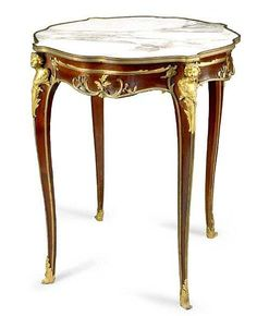 """FRANCOIS LINKE (1855-1946) A Very Fine French Louis XV Style Figural Gilt-Bronze Mounted Mahogany Guèridon fitted with a mottled white and rouge marble-inset top. The ormolu signed: F. Linke and stamped on the back """"FL"""". Circa: Paris, 1895"""