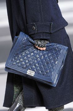 Chanel Fall 2013 - I love how the model is digging her fingers into this expensive bag in order to hold onto it.  Must be soft leather!