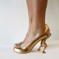 """3D-printed shoes that represent 12 of Sebastian Errazuriz's lovers-- """"Gold Digger"""" what a high maintenance woman!"""
