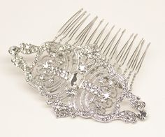 Vintage inspired rhinestone bridal hair comb featuring a classic brooch design by Hair Comes the Bride.