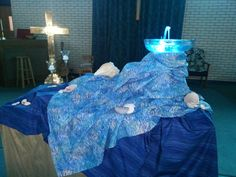 Altar scape for Baptism of the Lord Sunday.  NOTE fountain in glass bowl, and shells, another symbol of baptism