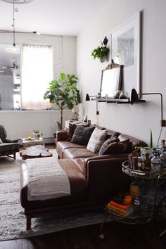 that couch  -  Allison & Matt's East Village Synergy — Video House Tour | Apartment Therapy