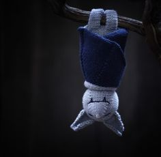Yet ANOTHER reason why I need to learn how to knit... on the other hand, I bet this little darling would be easy to give the ami-treatment to  :)   Sleeping Bat Knitting Pattern