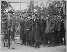 """Officers and crew of the German submarine U.58, captured by the U.S.S. Fanning, entering the War Prison Camp at Fort McPherson, Georgia."""" National Archives"""