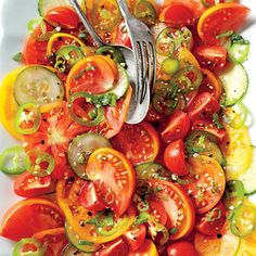 Serve a slice of summer with a tomato and cucumber salad. The vinaigrette is made with salty soy sauce, but before serving, sprinkle a pinch of flaky sea salt to add texture to the fresh tomatoes!!