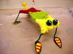 Woven creatures - love this idea, string wire through sides of carboard looms and tape down until finished. Super cool!
