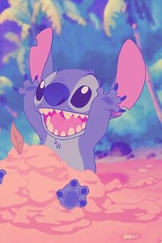 what happens with most peoples sandcastles...but i love his excitement...Stitch is adorable