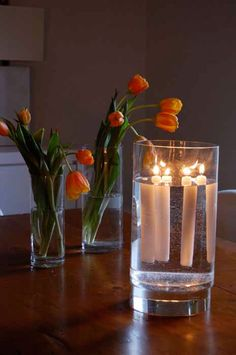Floating taper candles, secure a washer onto the bottom of the candle with a thumbtack.