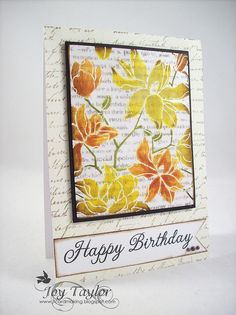 """By Joy Taylor.  Stamp text stamp with Distress pumice stone ink onto white card stock. Heat set. Ink Hero Arts """"Large Blossom"""" negative stamp in VersaMark & stamp over text. Heat emboss with clear powder. Sponge flowers with Distress wild honey rusty hinge, mustard seed, scattered straw, & peeled paint. Stamp another text stamp onto card front in walnut stain. Sponge edges of flower image panel & mat with dark brown cardstock; pop up onto card base. Add sentiment & pearls."""